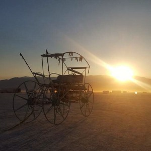 Spoono's art car at sunrise after early man. I will miss seeing him riding around on playa